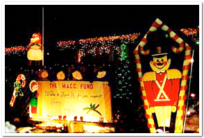 The MACC Fund sign and decorations at Candy Cane Lane
